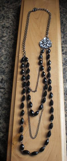 Black beaded necklace with rhinestone focal