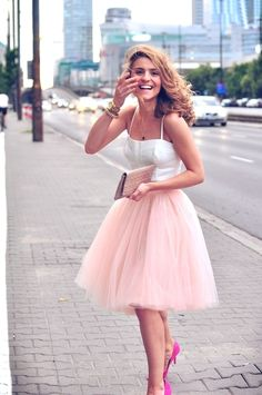 pretty pink tulle skirt! cute purse!