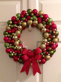 Ornament Christmas wreath.  Be bold with your house decorated in red, green, and gold.