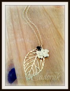 Gold plated leaf with daisy charm