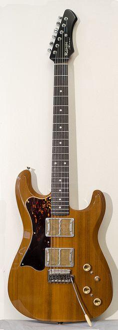 "Ronin Guitar's Mirari Foilbucker Guitar built from Master Grade Reclaimed Old Growth Redwood. The pickups are Ronin-built and custom fabricated ""Foilbuckers""."