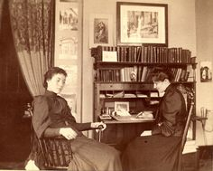Students study and relax in their dorm room, Vassar College, NY, 1910.