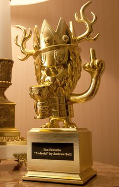 GOLD Toy award trophy by Pete Fowler