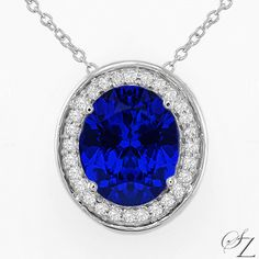 Breathtakingly beautiful... an exquisite, vibrant blue Tanzanite outlined in fine Diamonds. Bold and exceptionally chic, this pendant really will make a statement.