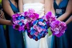Blue and purple bouquets with blue bridesmaid dresses