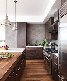 Kitchen | Wood floors, dark wood cabinets, crisp white ceiling and shining lamps, love everything