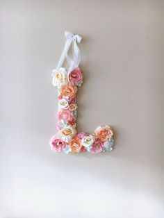 This listing is for custom flower letter in pastels - candy pink and peach, white, mint and creams, 45 cm/17.8 height (please contact me if you would like a smaller 35cm/13.8 letter or any other colors).  A perfect decor for your dream interior, birthday party or wedding - will freshen up any type of room - nursery, bedroom, childrens room.  Letter is made with high quality artificial flowers on a foamboard base.  Variations in flowers will occur due to availability of flowers at the time…