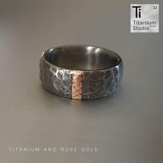 Titanium base ring with hammered finish and rose gold inlay. The titanium has been treated in order to give it a darkened gun metal grey color. Rustic Jewelry, Titanium Rings, Jewelry Collection, Wedding Bands, Gun, Gold Rings, Rings For Men, Rose Gold, Base