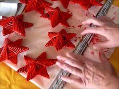 Estrellas navideñas con tubos de papel de periódico