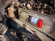 The jar seen here is typical of the size of a geocache.  Although this one was hidden inside a hollowed log, they can also simply be hidden under things like leaves.  Note the international geocaching logo on the cache jar.  Inside, a log sheet is there for the finder to sign.  Find enough geocaches and redeem goods and activities available during your stay.  (photo from Jim and Sarah's Flickr page: http://www.flickr.com/photos/jimsarahmiller/3411142408/)