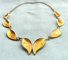 Yellow Norwegian silver enamel necklace. Designer: Willy Winnæss. Read more about the designer at the web page: http://solvstempler.no/willy_winnaes.html