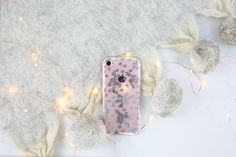 The Snow Blossoms Case for iPhone 7. Cozy up to the fire and let the flurries fly with the Snow Blossom Case. Adorned by white laurels and perfect puffs of powder, this one piece case protects and shows off your beautiful device.