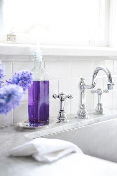 Tracey Ayton Photography - bathrooms - purple accents, purple bath accents, purple bathroom accents, white carrera marble, white carrera marble top vanity, subway tile, subway tile backsplash, white lacquer mirror,