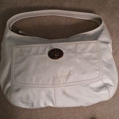 Vintage Coach Beautiful Patented White Leather Beautiful Patented Leather White Coach Vintage. Good condition overall.  Leather condition consistent with light Vintage use. My best guess this is from the 1960's or 1970's. Inside looks like it has never been used. Coach Bags Hobos