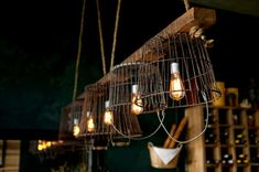 I love these custom built light fixtures (made from vintage metal baskets!), from The Smoking Goat restaurant. http://thesmokinggoatrestaurant.com.