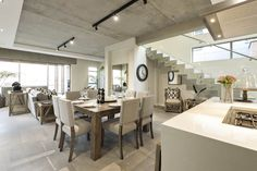 The development in which this unit is located is all about pushing conventional boundaries. My House, Conference Room, Dining Table, The Unit, Homes, Natural, Furniture, Home Decor, Homemade Home Decor