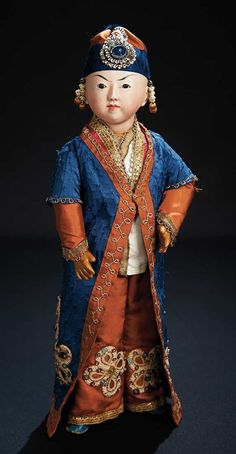 """Bisque Exotic Child in Exhibition Costume. probably French, late 19th century. 15"""" (38 cm)"""