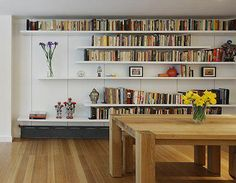dining-rooms-loft-spaces-light-wood-multi-colored-books-bookshelves-dining-tables