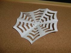 Daily Origami:  143 - Halloween - Spider Web