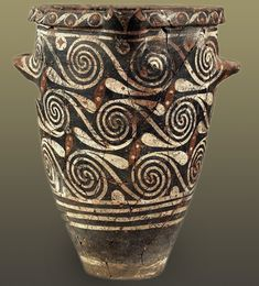 Small Kamares ware jar, with bands and interconnected spirals, Palaeopalatial Period (1900 – 1700 BC) Heraklion Museum
