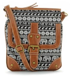 """Channel your inner tribal vibe with an elephant print cross body:<br/>canvas and faux-leather cross body, top zip closure, all-over elephant print, front pocket with snap closure and buckle detailing, gold-toned hardware, inner side zip, cell and slip pockets, adjustable strap adjusts to 26"""" drop, dimensions 8"""" L x 9.5"""" H"""