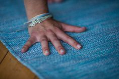 Handwoven cotton. No machines involved. No electricity involved. #masterweavers #yogasanamats #watermat Yogi: @AlyssaKuzins Photo cred: Abie Livesay
