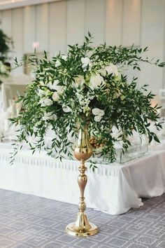 lots of greenery and white flowers for wedding set - oh so pretty