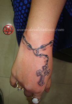 Cross Tattoo On Wrist With Bible Verse Rosary Tattoo, similar placement/design. Rosary Tattoo, similar placement/design. Cross Tattoo On Wrist With Bible Verse Rosary Tattoo On Hand, Rosary Foot Tattoos, Rosary Bead Tattoo, Cross Tattoo On Wrist, Wrist Tattoos, Finger Tattoos, Body Art Tattoos, Sleeve Tattoos, Ankle Tattoo