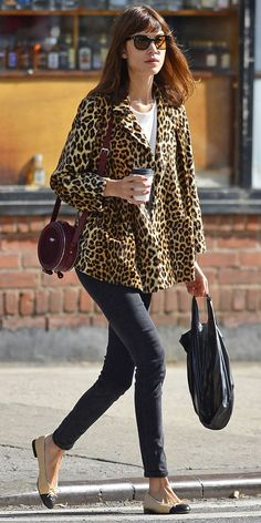 Alexa Chung wears a white top, leopard blazer, round bag, skinny jeans, and Chanel flats