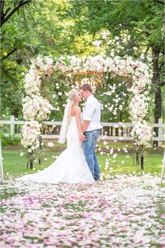 A stunning blush pink & ivory wedding with vintage details and full floral ceremony arch. The bride wore a strapless mermaid lace gown. The wedding bouquets were made with pink, peach and ivory roses and lace wrap - Photos by Drew Brashler Photography