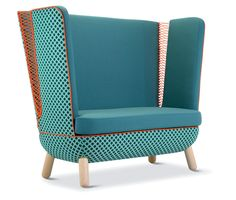 Witness the corners of the armchair and the loveseat: Hand-laced polyester cord threads between the arms and the seat backs.