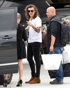 Reunited: Harry Styles jetted into Chicago on Wednesday, to be reunited with the rest of One Direction