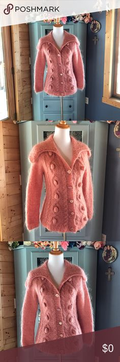 FREE PEOPLE Rare MoHair Sweater. Brand NEW! Brand NEW!  Wow!  This is absolutely stunning!!!  Super soft mohair yarn blend that's so so soft and not at all itchy.  Cardigan is button front w/adorable buttons that are flower shaped w/ a simulated diamond in the center.  Sweater does have stretch to it. Exceptional quality here with this beauty. Perfect staple for any closet. You can enjoy this season after season. Very well made. Size Medium.  72% mohair, 21% polyester, 7% acrylic. Use the…