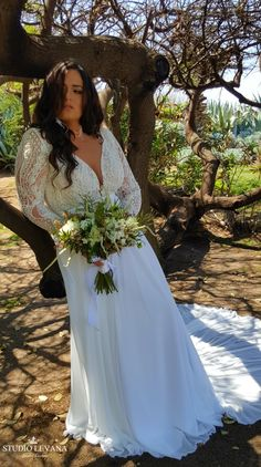 Plus size bohemian wedding gown with long lace sleeves and long chiffon train. Margo. Studio Levana