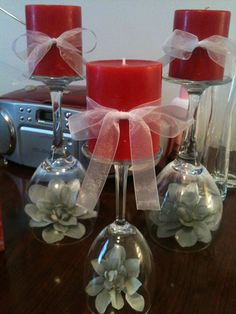 My wedding reception centerpiece for bride/groom table! Colors of wedding are red and gray....splashes of white to keep everything from blending in! Everything came from the dollar tree! Wine glass + flowers (spray painted gray) + candles + sheer ribbon = million dollar look for $8!