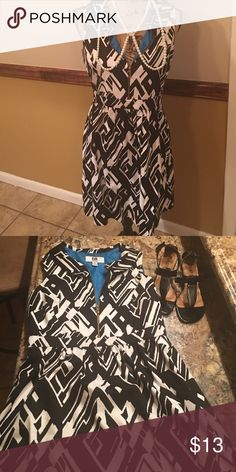 Black and white print dress Dress is black and white with a blue lining. Dress size 8. Dress has zipper in the front to zip up or down to show chest if like. Dress zips on the side for fastener. Dress is fit and flare. Would look be great for work. Dress has been worn but in good condition...   shoes are not part of the sale but you could add them in a bundle with the dress jcpenney Dresses Midi
