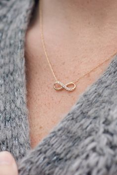 This dainty diamond infinity necklace in quality 14k yellow gold is perfect as a bridesmaid gift or as a casual fashion piece for both work and everyday looks. Wear alone or as a layered necklace for a chic style.