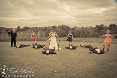 Perfect wedding picture. (minus the one guy standing. ALL the guys should be on the ground :)