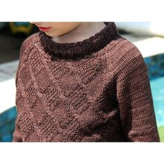 Boy's sweater with texture pattern on the front, roll neck and raglan long sleeves.This pattern for size 4-5 years only.Skills required: Rib 2x2 in the round knitting cables reading chartsThe texture pattern is on chart only. You must be able to read charts for this pattern.