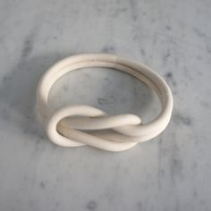 Items similar to Porcelain Knot Bracelet on Etsy Polymer Clay Projects, Diy Clay, Handmade Polymer Clay, Polymer Clay Jewelry, Ceramic Jewelry, Ceramic Beads, Cold Porcelain Jewelry, Clay Beads, Ceramic Pottery