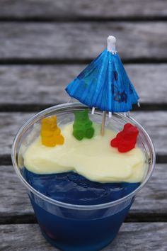 Bears at the beach. Blue jello, vanilla custard, with gummy bears and umbrellas. What a cute kids party idea.