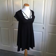 """Strappy Tunic/Dress Black strappy tunic or dress. Can be worn either way. Medium measurements laying flat are length: 27"""" bust 14"""". Very stretchy material. 95% rayon, 5% spandex. Very soft and comfy. Brand new with tags. True to size. April Spirit Tops Tunics"""