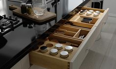 Classic contemporary shaker kitchen drawer in beige and cream and oak showing excellent drawer storage. Design & CGI by pikcells.