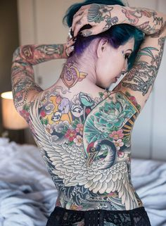 Amazing back tattoo! But can we also talk about her charmander, sailor moon crystal, and Mulan comb? Awesome.