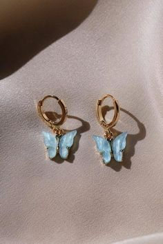 You will surely want to own our Butterfly Earrings. They feature small hoops with pearly butterflies that hang just below the ears. Use this piece on its own or to complement other earrings if you have extra ear piercings. Crystal Earrings, Statement Earrings, Gold Earrings, Drop Earrings, Gold Bracelets, Fancy Earrings, Beaded Earrings, Indian Earrings, Stackable Bracelets