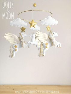 Items similar to Pegasus baby mobile, nursery mobile pegasus, pegasus nursery decor, baby mobile clouds stars pegasus, nursery gold white whimsical on Etsy Baby Mobile Felt, Baby Crib Mobile, Baby Cribs, Baby Mobiles, Gold Nursery Decor, Baby Decor, Nursery Ideas, Project Nursery, Baby Born Clothes
