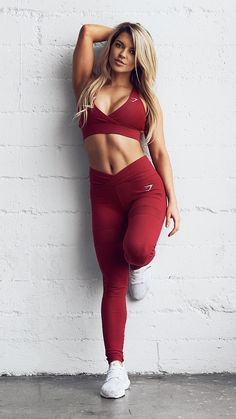 Gymshark by Nikki Blackketter Cross Back Sports Bra with the Dynamic Leggings in 'beet'.
