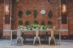 A backdrop of banana leaves, how creative and cute, great inspo for our next warehouse gathering gala.