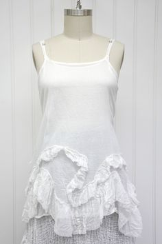"""Features:    Beautiful camisole   Full hem   Raw edge ruffled detail along bottom   Skinny straps   Side ties   100%Cotton Voile, White   Fits sizes 2-18   Measurements:    Chest: about 50"""" wide   Length: about 33"""" long"""