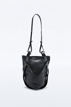 Black leather handbag, chic bag design // All Hands • @malinamf